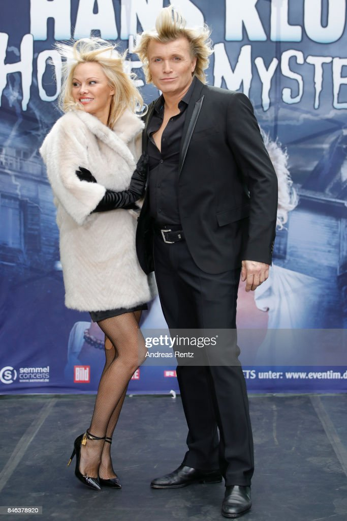 Illusionist Hans Klok and Pamela Anderson attend a photocall for their upcoming show 'House of Mystery' on September 13, 2017 in Cologne, Germany.