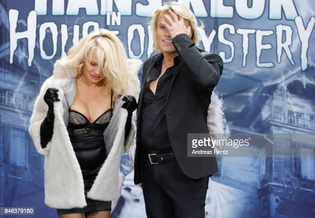 Illusionist Hans Klok and Pamela Anderson attend a photocall for their upcoming show 'House of Mystery' on September 13 2017 in Cologne Germany