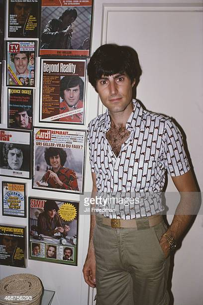 Illusionist Uri Geller with a collection of magazine covers featuring himself 1978