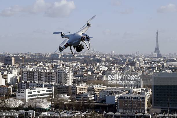 Illustrarion of a drone flying over SaintCloud near Paris on Febuary 27 2015 One of three AlJazeera journalists arrested for flying a drone in Paris'...