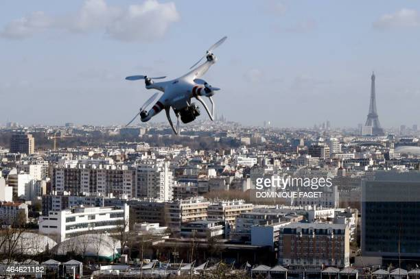 Illustrarion of a drone flying over SaintCloud near Paris on February 27 2015 One of three AlJazeera journalists arrested for flying a drone in...