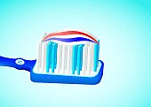 illustrated blue toothbrush with toothpaste and red white stripes