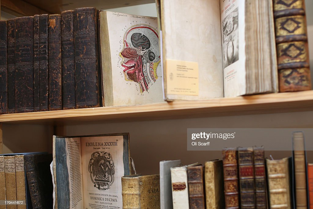 Illustrated books are displayed at the London International Antiquarian Book Fair in the Olympia exhibition centre on June 13, 2013 in London, England. The Antiquarian Booksellers' Association was founded in 1906 and their book fair is the oldest in the UK having run for 56 years. It attracts approximately 200 book dealers from around the world, selling fascinating and rare books, maps, prints and manuscripts.