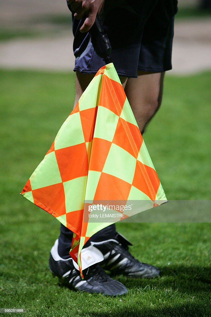 Illustration assistant referee with his flag during the Montceau Les Mines vs FC Sochaux French Cup soccer match