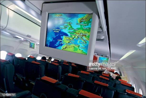 Illustration Austrian airlines In Vienna Austria On November 20 2002 Flight display in Austrian Airline Airbus A321cabin
