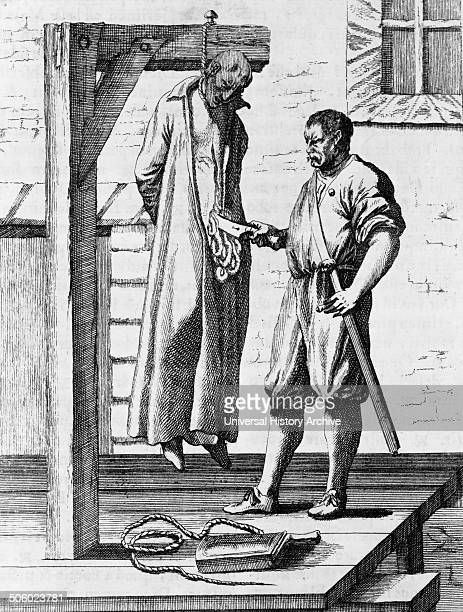 Illustration depicting John Ogilvie hanging from the gallows while the executioner cuts open his abdomen with a large knife Dated 1675 Photo by