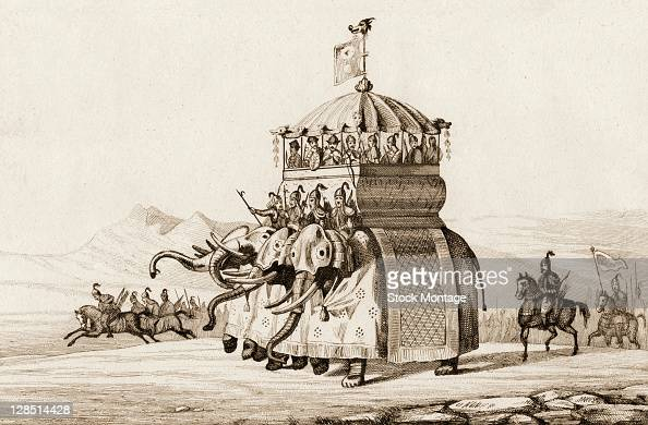Illustration depicts four armored elephants as they jointly carry a howdah filled with soldiers part of Kublai Khan's forces others of whom are seen...