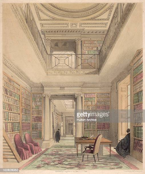 Illustration entitled 'The Library' depicting a booklined room with a desk and three chairs and a figure sitting reading on a window seat circa 1850A...