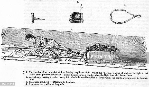 Illustration from the Children's Employment Commission Report A young boy wearing a skullcap with a candle attached is shown pulling a loaded wooden...