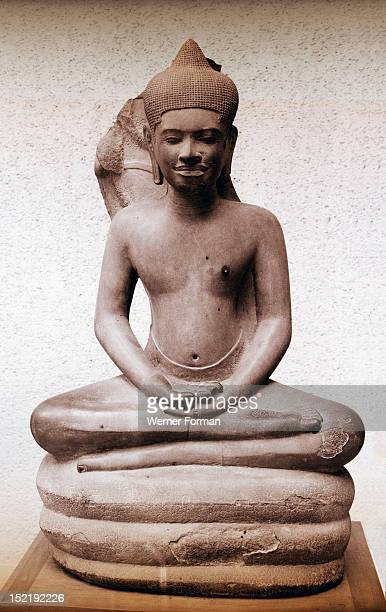 Illustration from the life of the Buddha The seprent Mucilinda makes a seat out of its coils for Buddha to meditate Cambodia Buddhist Angkor Wat...