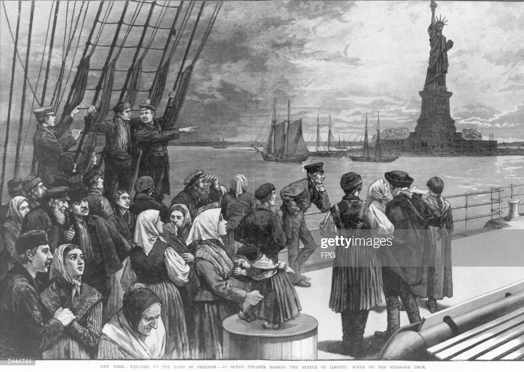 Illustration of a group of immigrants on the steerage deck of a steamship viewing the Statue of Liberty as they arrive in New York Harbor, circa 1887.