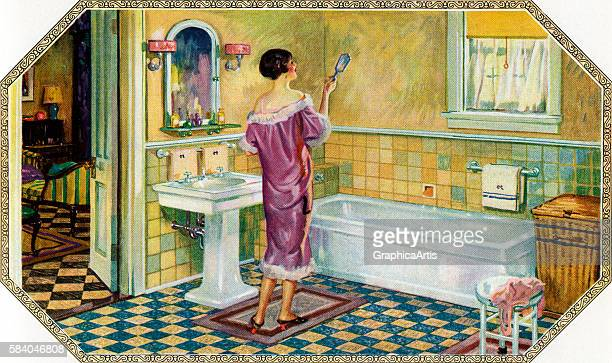 Illustration of a woman looking in a hand mirror standing by a bathtub in an Art Deco style bathroom 1927 Screen print