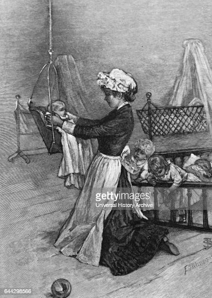 Illustration of a young nursemaid preparing the youngest children for bed at the orphanage Dated 19th Century
