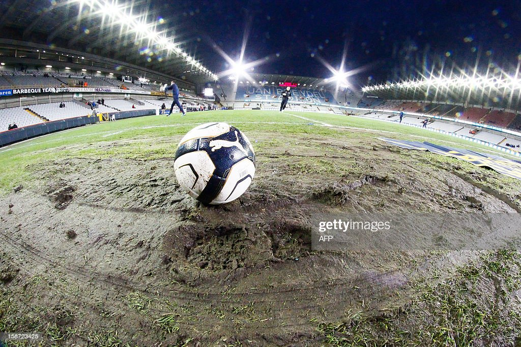 Illustration picture shows a ball on the muddy damaged pitch before the Jupiler Pro League match between Club Brugge and KV Kortrijk, in Brugge on December 26, 2012 during the Belgian football championship.