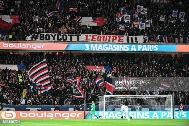 Illustration picture shows fans of PSG with a banner against the newspaper L'Equipe during the French Ligue 1 match between Paris Saint Germain and...