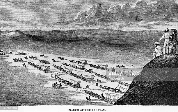Illustration titled 'The March of the Caravan' depicting a wagon train passing over the prairie taken from 'Commerce of the Prairies' by Josiah Gregg...