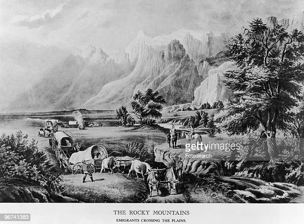 Illustration titled 'The Rocky Mountains Emigrants Crossing The Plains' depicting a wagon train passing through the mountains USA date unknown