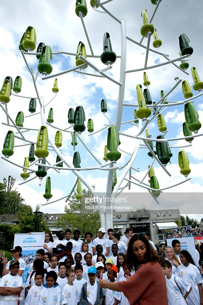 Illustration view of the Tree Wind Turbine - Founding President of 'Fete le Mur' Association, Yannick Noah, blows out candles for the 20th Anniversary of the Association, with children of the Association and the Engie Foundation in front of the Tree Wind Turbine during the 2016 French Tennis Open - Day Four at Roland Garros on May 25, 2016 in Paris, France.
