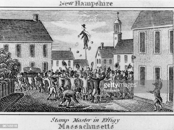 Illustration with the caption 'New Hampshire Stamp Master in Effigy Massachusetts' Depicting protestors of the Stamp Act burning the stamp master in...