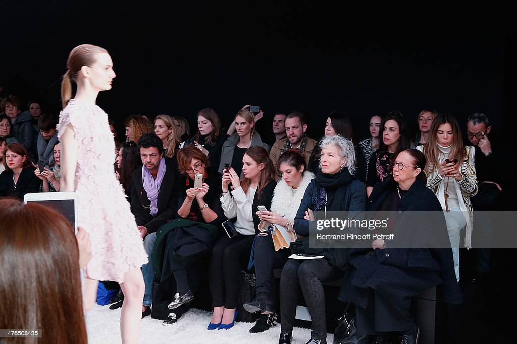 Illustrationn View of People taking pictures and movies with their smartphone whyle the Giambattista Valli show as part of the Paris Fashion Week Womenswear Fall/Winter 2014-2015 on March 3, 2014 in Paris, France.