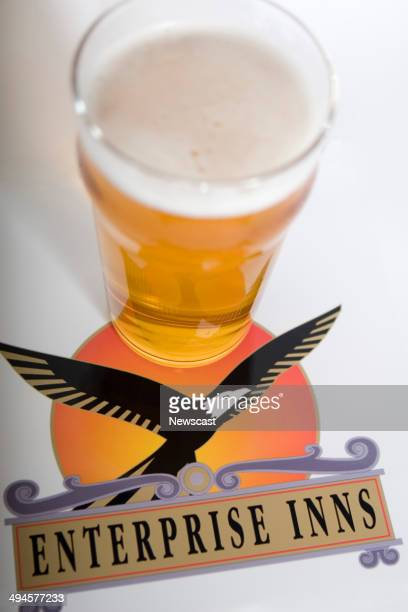 Illustrative image of the Enterprise Inns logo and a pint of larger