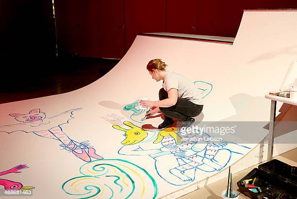 Illustrator and comic artist Lisa Hanawalt paints on a half pipe during the Audi A3 #PaidMyDues Experience at Hangar 8 In Santa Monica on May 7 2014...