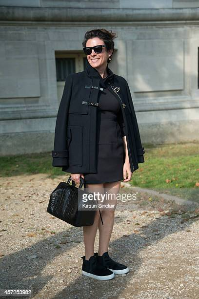 Illustrator Garance Dore is wearing a Zara dress jacket and shoes and Phillip Lim bag on day 8 of Paris Collections Women on September 30 2014 in...