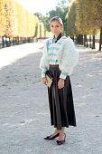 Illustrator Jenny Walton wears a vintage bag jacket and skirt Miu Miu shoes and Dries Van Noten top on day 3 during Paris Fashion Week Spring/Summer...