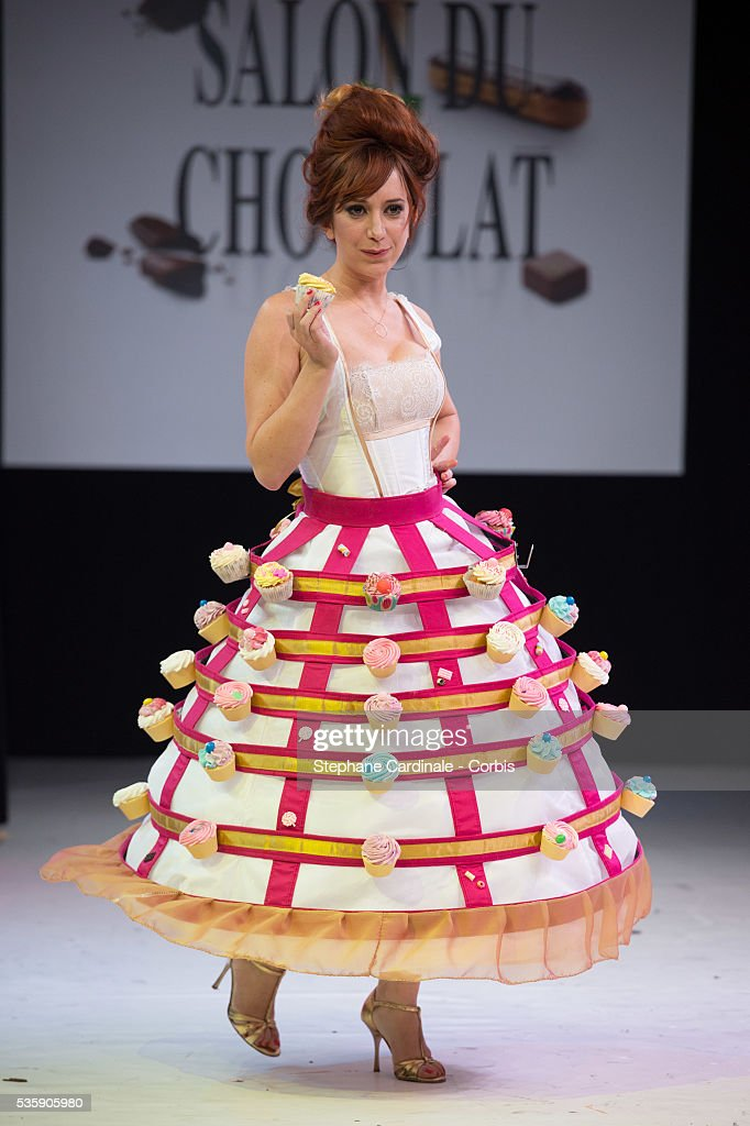 Illustrator Penelope Bagieu walks the runway and wears 'Cup Cakes' a chocolate dress made by fashion label Freyagushi and pastry maker Melodie Asseraf during the Fashion Chocolate Show at Salon du Chocolat at Porte de Versailles, in Paris.