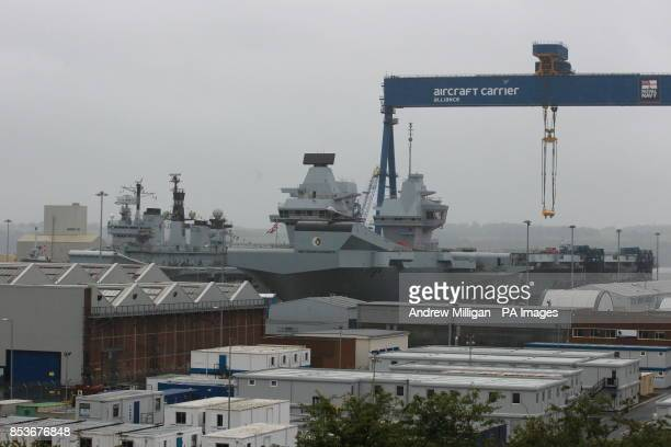 HMS Illustrious alongside HMS Queen Elizabeth after formal naming ceremony at in Rosyth Dockyard Fife