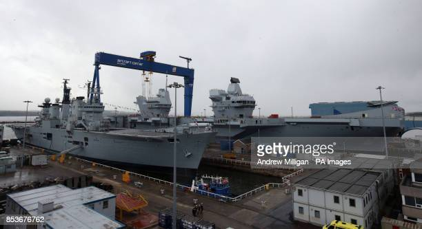 HMS Illustrious alongside HMS Queen Elizabeth after the formal naming ceremony at in Rosyth Dockyard Fife