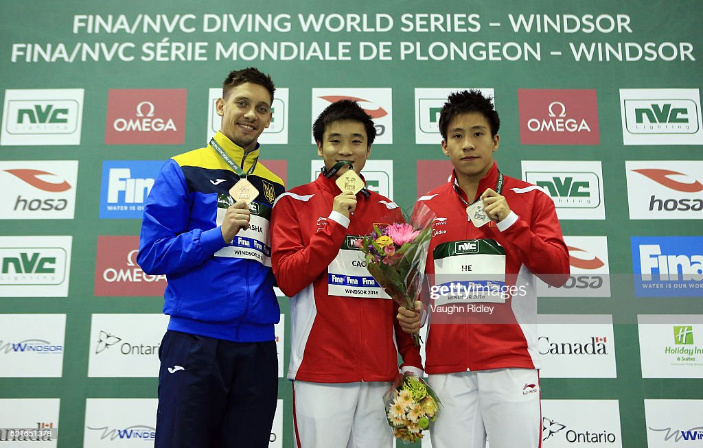 <a gi-track='captionPersonalityLinkClicked' href=/galleries/search?phrase=Illya+Kvasha&family=editorial&specificpeople=2305919 ng-click='$event.stopPropagation()'>Illya Kvasha</a> of Ukraine wins Bronze, Yuan Cao of China wins Gold and Chao He of China wins Silver in the Men's 3m Final during Day Two of the FINA/NVC Diving World Series 2016 at the Windsor International Aquatic and Training Centre on April 16, 2016 in Windsor, Ontario, Canada.
