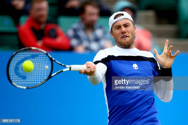 Illya Marchenko of Ukraine plays a forehand during his first round match against Liam Broady of Great Britain during day one of the Aegon Open at...