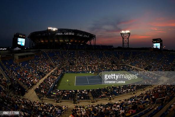 Illya Marchenko of Ukraine returns a shot against Gael Monfils of France during their Men's Singles First Round match on Day One of the 2015 US Open...