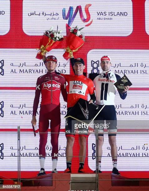 Ilnur Zakarin of Russia and Team Katusha Alpecin Rui Costa of Italy and UAE Abu Dhabi and Tom Dumoulin of the Netherlands and Team Sunweb celebrate...