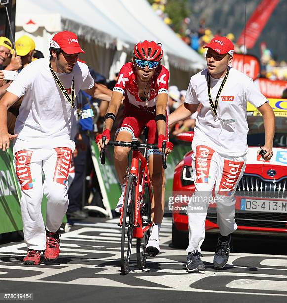 Ilnur Zakarin of Russia and Team Katusha is helped by medics after crossing the finishing line after winning the 1845km stage seventeen of Le Tour de...