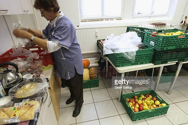 Ilona a volunteer at the Falkenseer Tafel food bank prepares groceries for the onceaweek food distribution on October 15 2013 in Falkensee Germany...