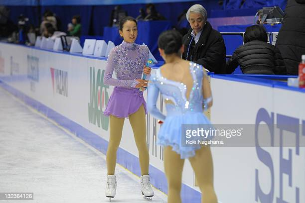 iLRjMao Asada of Japan and Akiko Suzuki of Japan perform in the official training during day two of the ISU Grand Prix of Figure Skating NHK Trophy...