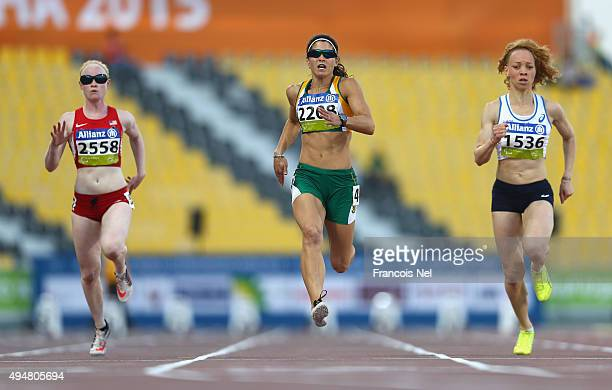 Ilse Hayes of South Africa wins the women's 100m T13 final during the Evening Session on Day Eight of the IPC Athletics World Championships at Suhaim...