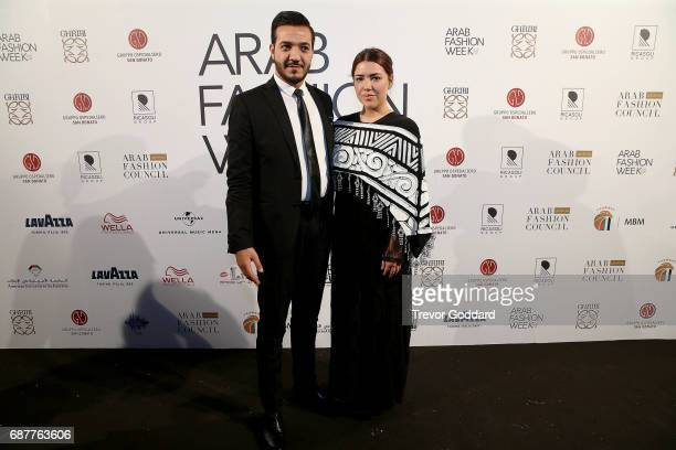 Ilse Jara and guest attend the Arab Fashion Week Ready Couture Resort 2018 Gala Dinner on May 202017 at Armani Hotel in Dubai United Arab Emirates
