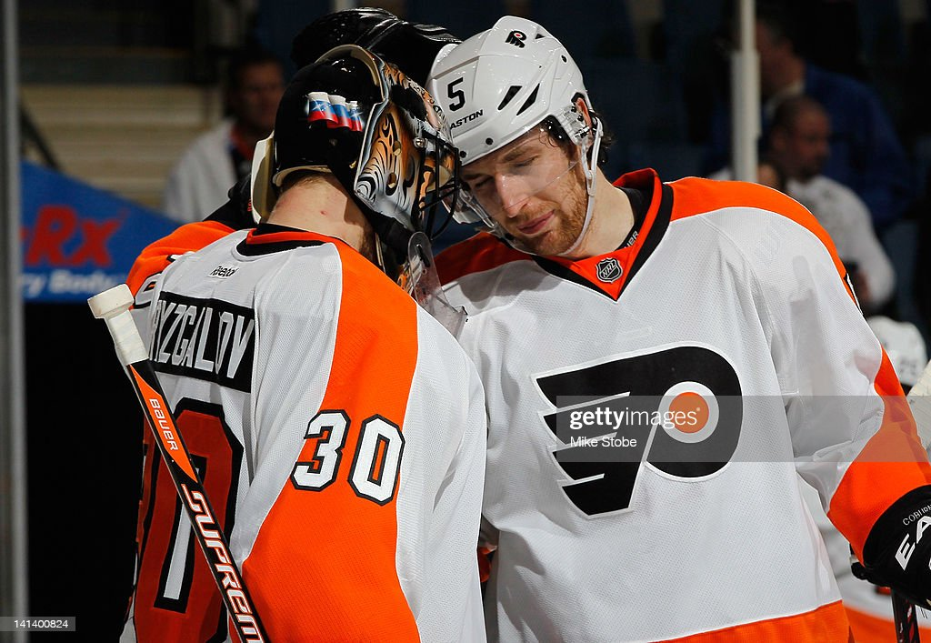 <a gi-track='captionPersonalityLinkClicked' href=/galleries/search?phrase=Ilya+Bryzgalov&family=editorial&specificpeople=2285430 ng-click='$event.stopPropagation()'>Ilya Bryzgalov</a> #30 and <a gi-track='captionPersonalityLinkClicked' href=/galleries/search?phrase=Braydon+Coburn&family=editorial&specificpeople=2077063 ng-click='$event.stopPropagation()'>Braydon Coburn</a> #5 of the Philadelphia Flyers congratulate each other on their win after the game against the New York Islanders at Nassau Veterans Memorial Coliseum on March 15, 2012 in Uniondale, New York. The Philadelphia Flyers defeated the Islanders 3-2.