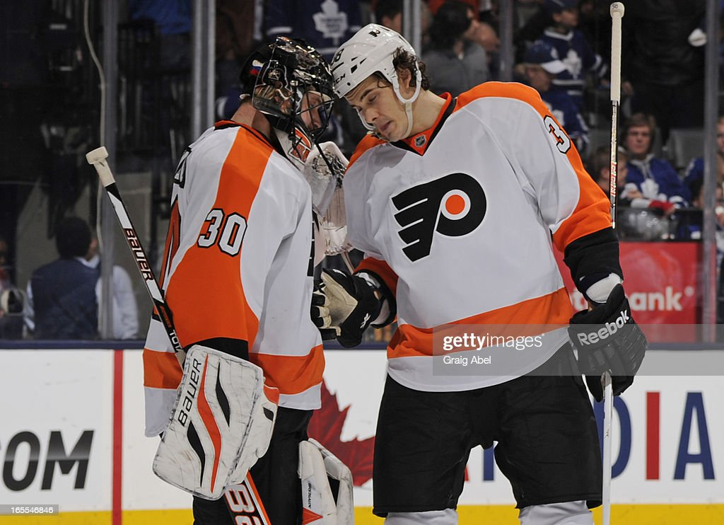 <a gi-track='captionPersonalityLinkClicked' href=/galleries/search?phrase=Ilya+Bryzgalov&family=editorial&specificpeople=2285430 ng-click='$event.stopPropagation()'>Ilya Bryzgalov</a> #30 and Oliver Lauridsen #38 of the Philadelphia Flyers celebrate the team's win over the Toronto Maple Leafs during NHL game action April 4, 2013 at the Air Canada Centre in Toronto, Ontario, Canada.