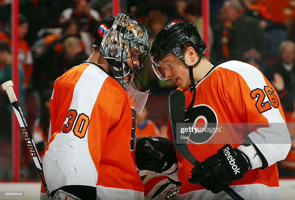 <a gi-track='captionPersonalityLinkClicked' href=/galleries/search?phrase=Ilya+Bryzgalov&family=editorial&specificpeople=2285430 ng-click='$event.stopPropagation()'>Ilya Bryzgalov</a> #30 and <a gi-track='captionPersonalityLinkClicked' href=/galleries/search?phrase=Ruslan+Fedotenko&family=editorial&specificpeople=201996 ng-click='$event.stopPropagation()'>Ruslan Fedotenko</a> #26 of the Philadelphia Flyers celebrate the win over the Carolina Hurricanes on February 2, 2013 at the Wells Fargo Center in Philadelphia, Pennsylvania.The Philadelphia Flyers defeated the Carolina Hurricanes 5-3.