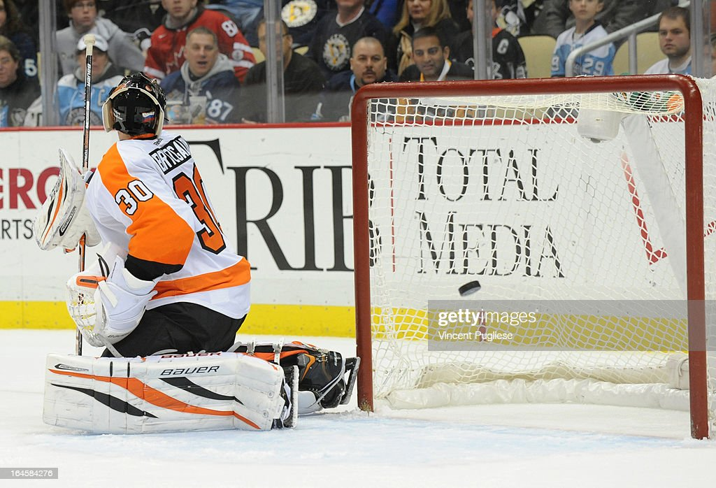 Ilya Bryzgalov #30 gets beat by <a gi-track='captionPersonalityLinkClicked' href=/galleries/search?phrase=Tyler+Kennedy&family=editorial&specificpeople=2119414 ng-click='$event.stopPropagation()'>Tyler Kennedy</a> #48 of the Pittsburgh Penguins (not pictured) for the game winning goal in overtime to give the Penguins a 2-1 victory on March 24, 2013 at the CONSOL Energy Center in Pittsburgh, Pennsylvania.