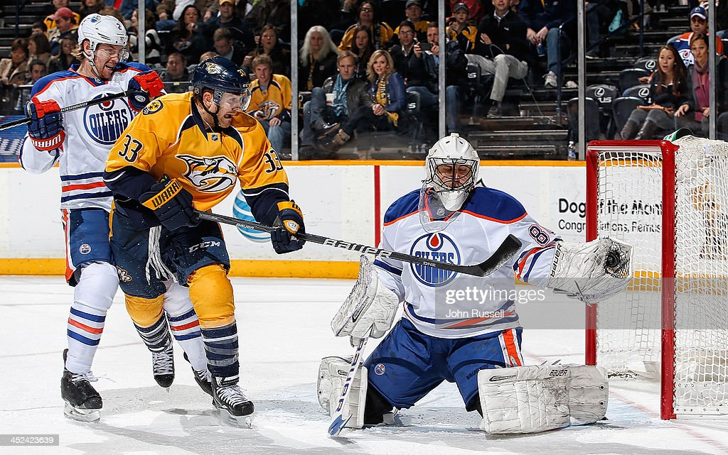 Ilya Bryzgalov of the Edmonton Oilers makes the save against Colin Wilson of the Nashville Predators as Oilers Jeff Petry defends at Bridgestone...