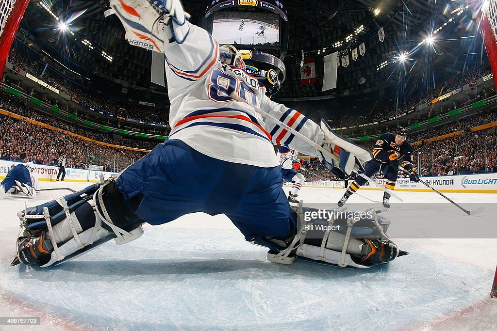 <a gi-track='captionPersonalityLinkClicked' href=/galleries/search?phrase=Ilya+Bryzgalov&family=editorial&specificpeople=2285430 ng-click='$event.stopPropagation()'>Ilya Bryzgalov</a> #80 of the Edmonton Oilers stretches to make a save on a shot by <a gi-track='captionPersonalityLinkClicked' href=/galleries/search?phrase=Marcus+Foligno&family=editorial&specificpeople=5662790 ng-click='$event.stopPropagation()'>Marcus Foligno</a> #82 of the Buffalo Sabres on February 3, 2014 at the First Niagara Center in Buffalo, New York. Edmonton won, 3-2.