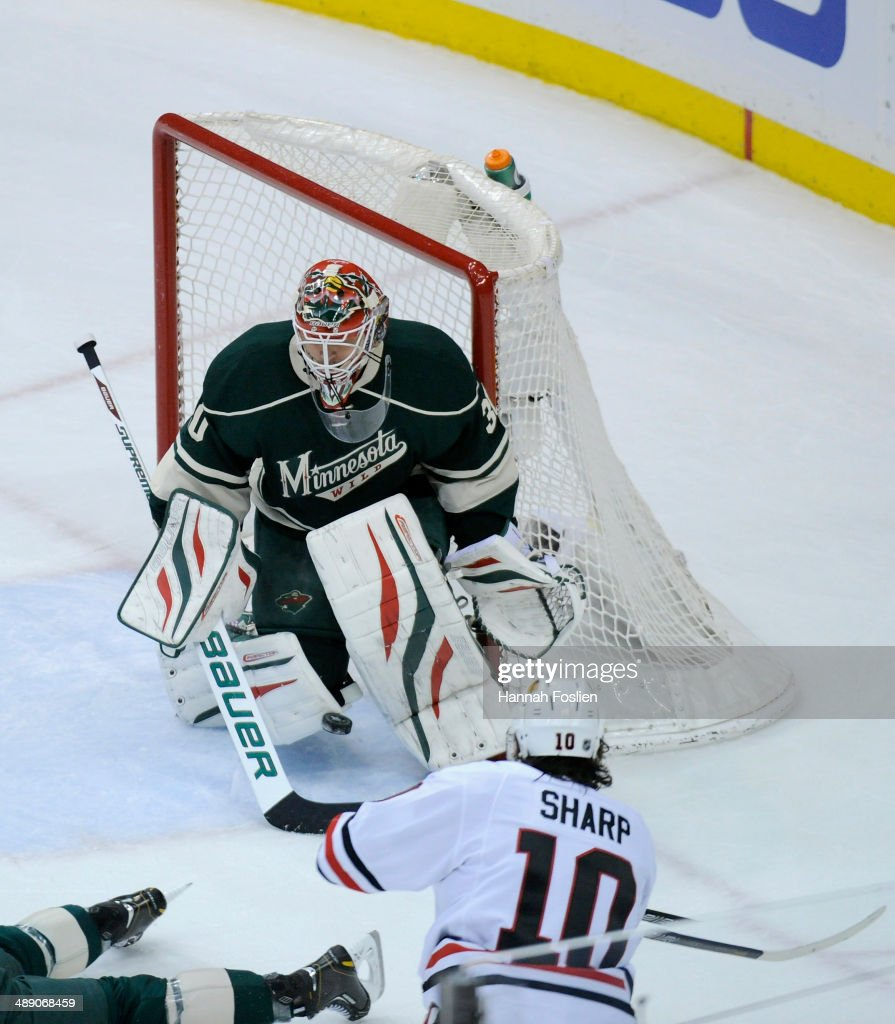 Ilya Bryzgalov #30 of the Minnesota Wild is unable to block a shot by Patrick Sharp #10 of the Chicago Blackhawks during the first period in Game Four of the Second Round of the 2014 NHL Stanley Cup Playoffs on May 9, 2014 at Xcel Energy Center in St Paul, Minnesota.