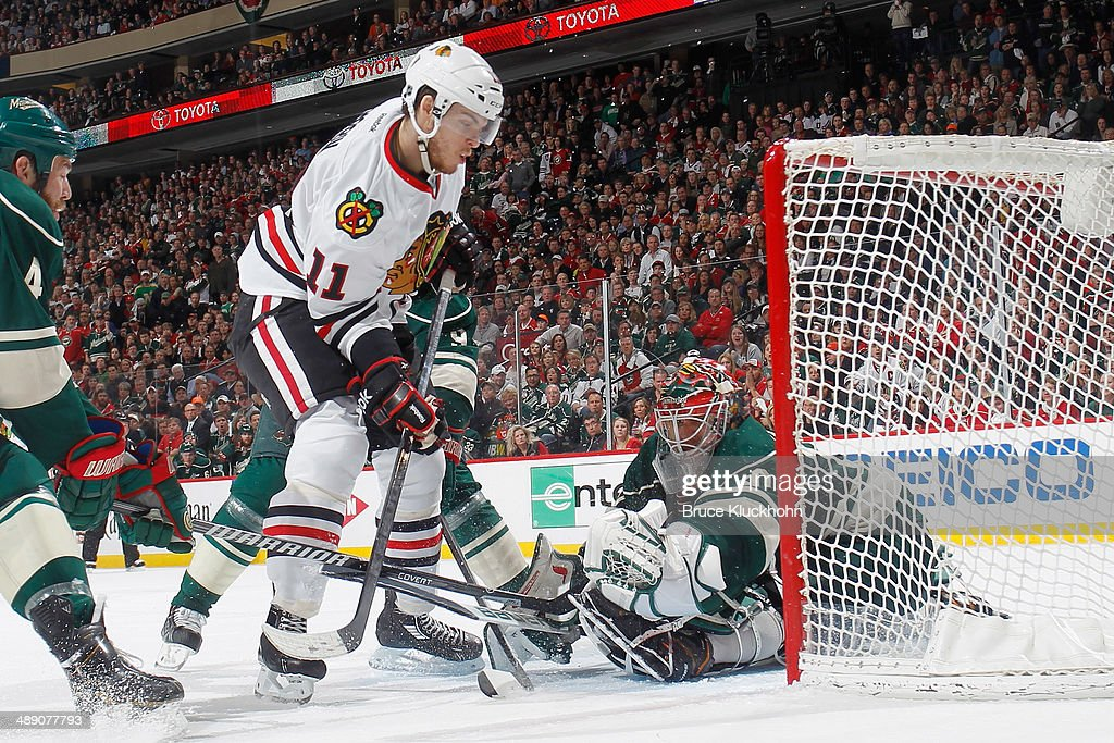 Ilya Bryzgalov #30 of the Minnesota Wild makes a save against Jeremy Morin #11 of the Chicago Blackhawks during Game Four of the Second Round of the 2014 Stanley Cup Playoffs on May 9, 2014 at the Xcel Energy Center in St. Paul, Minnesota.