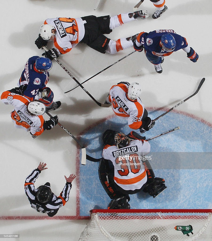 <a gi-track='captionPersonalityLinkClicked' href=/galleries/search?phrase=Ilya+Bryzgalov&family=editorial&specificpeople=2285430 ng-click='$event.stopPropagation()'>Ilya Bryzgalov</a> #30 of the Philadelphia Flyers covers the puck during the game against the New York Islanders at the Nassau Veterans Memorial Coliseum on March 15, 2012 in Uniondale, New York. The Flyers defeated the Islanders 3-2.