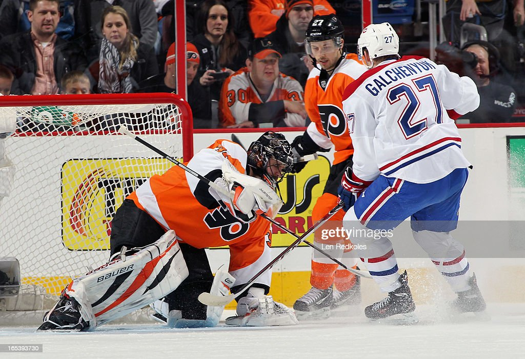 Ilya Bryzgalov #30 of the Philadelphia Flyers covers the puck in his crease while Alex Galchenyuk #27 of the Montreal Canadiens looks for a rebound on April 3, 2013 at the Wells Fargo Center in Philadelphia, Pennsylvania.